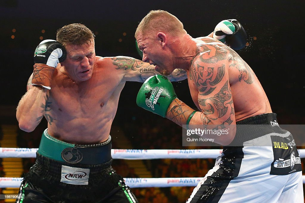 Danny Green of Australia and Shane Cameron of New Zealand exchange blows during their world title bout at Hisense Arena on November 21, 2012 in Melbourne, Australia.