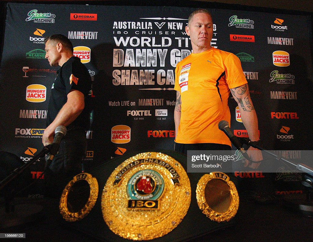 Danny Green of Australia and Shane Cameron of New Zealand look on after facing off during a press conference at Crown Entertainment Complex on...