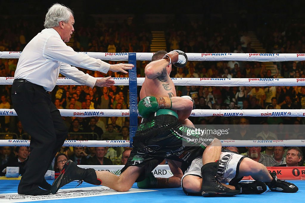 Danny Green of Australia and Shane Cameron of New Zealand wrestle each other to the ground during their world title bout at Hisense Arena on November 21, 2012 in Melbourne, Australia.
