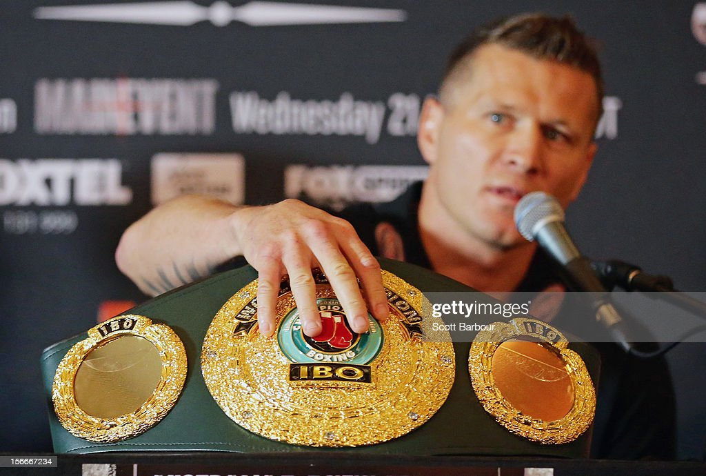 Danny Green of Australia touches the International Boxing Organization World Champion Belt during a press conference at Crown Entertainment Complex on November 19, 2012 in Melbourne, Australia. Danny Green and Shane Cameron meet in an IBO World Title bout on Wednesday.