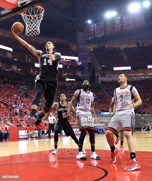 Danny Green of the San Antonio Spurs attacks the basket past James Harden and Ryan Anderson of the Houston Rockets during Game Six of the NBA Western...