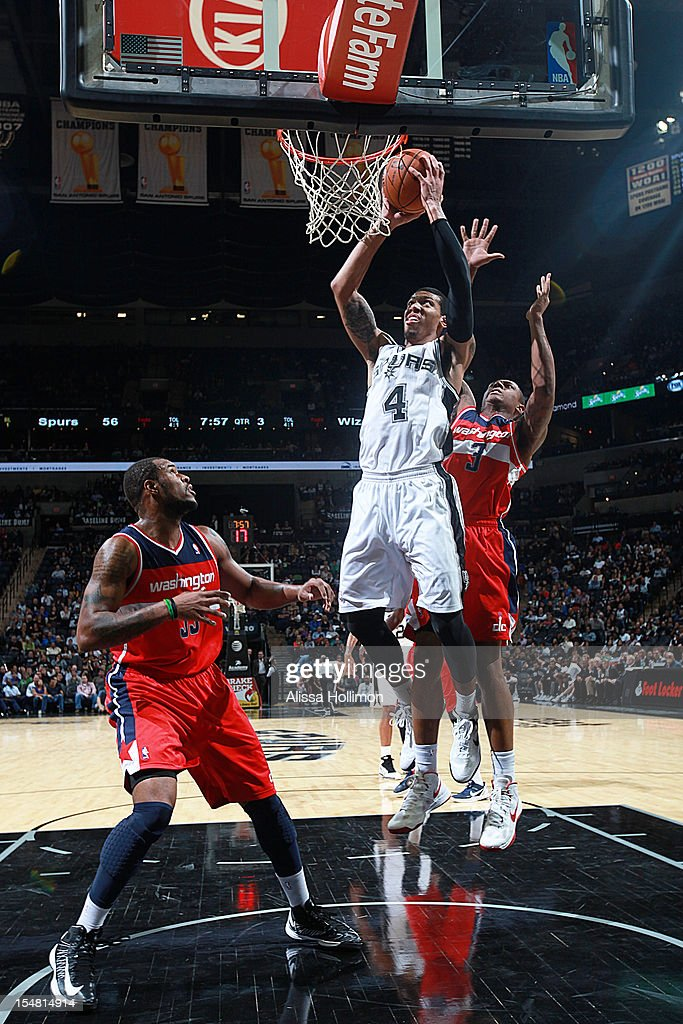 Danny Green #4 of the San Antonio Spurs attempts a dunk vs the Washington Wizards on October 26, 2012 at the AT&T Center in San Antonio, Texas.