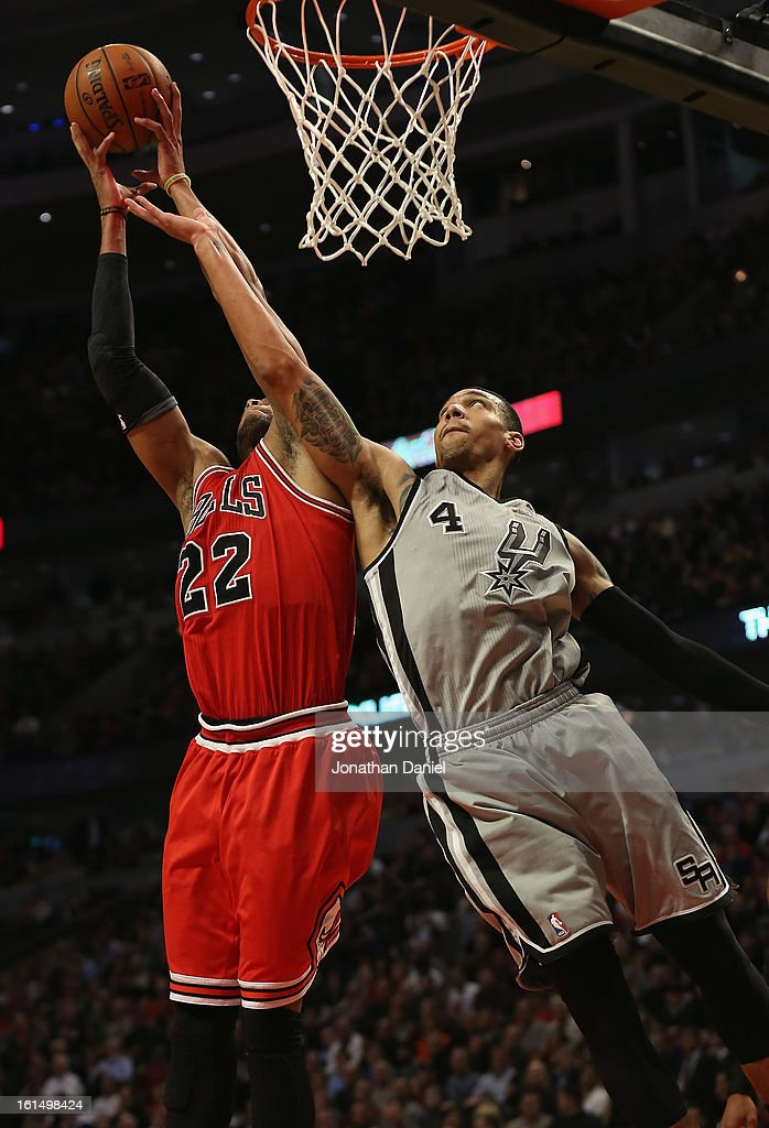 Danny Green #4 of the San Antonio Spurs battles for a rebound with Taj Gibson #22 of the Chicago Bulls at the United Center on February 11, 2013 in Chicago, Illinois. The Spurs defeated the Bulls 103-89.