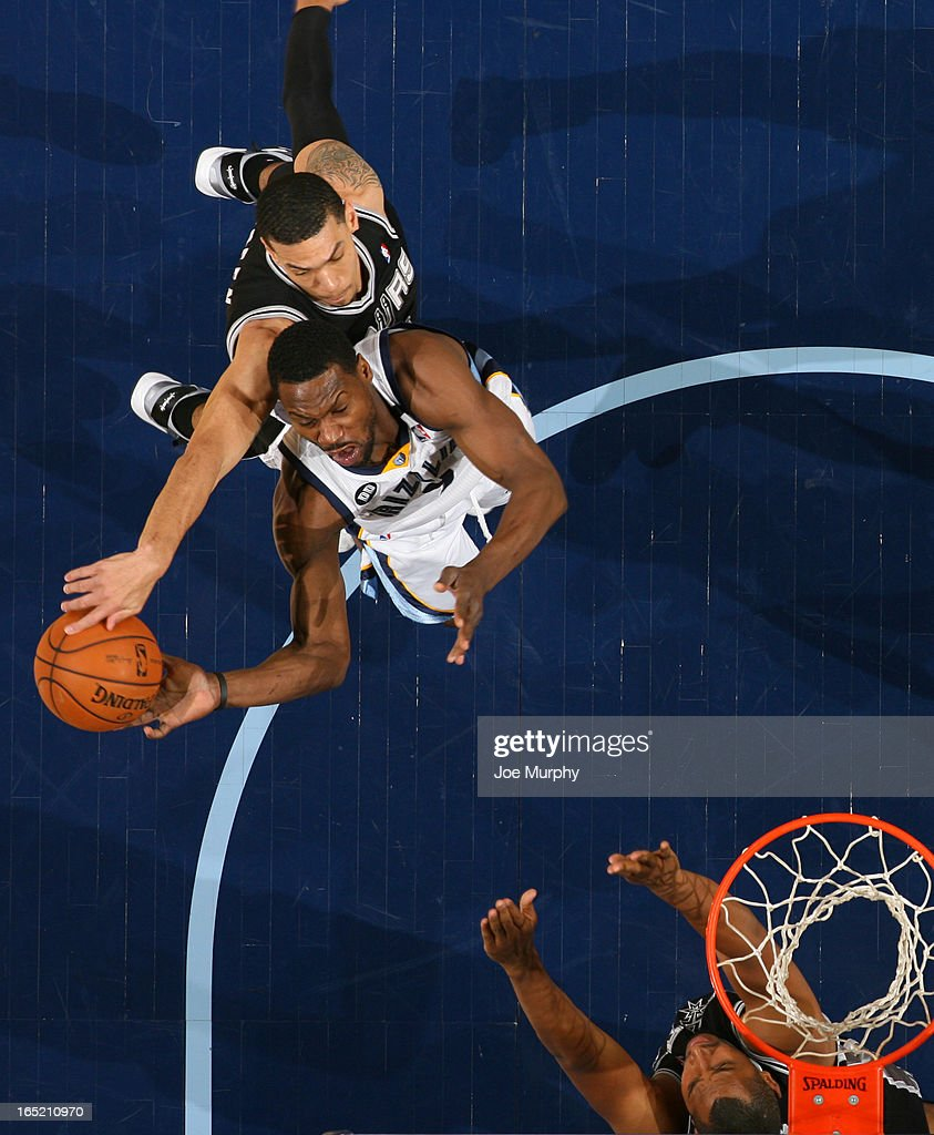 Danny Green #4 of the San Antonio Spurs blocks a shot attempted by <a gi-track='captionPersonalityLinkClicked' href=/galleries/search?phrase=Tony+Allen+-+Basketball+Player&family=editorial&specificpeople=201665 ng-click='$event.stopPropagation()'>Tony Allen</a> #9 of the Memphis Grizzlies on April 1, 2013 at FedExForum in Memphis, Tennessee.