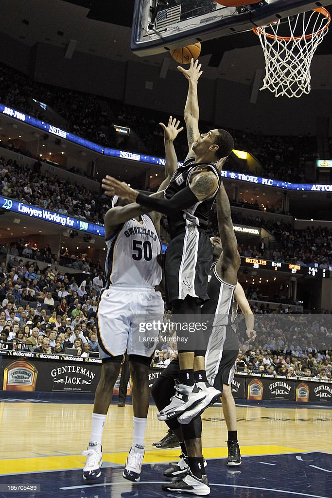 Danny Green #4 of the San Antonio Spurs blocks the shot of Zach Randolph #50 of the Memphis Grizzlies on April 1, 2013 at FedExForum in Memphis, Tennessee.