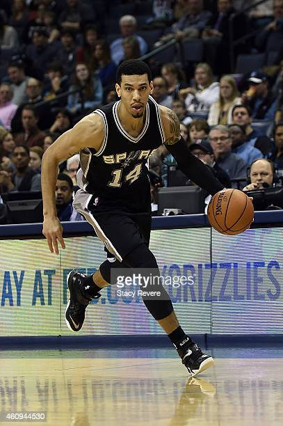 Danny Green of the San Antonio Spurs brings the ball up court against the Memphis Grizzlies at the FedExForum on December 30 2014 in Memphis...