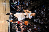 Danny Green of the San Antonio Spurs brings the ball up court against the Charlotte Hornets on January 28 2015 at the ATT Center in San Antonio Texas...