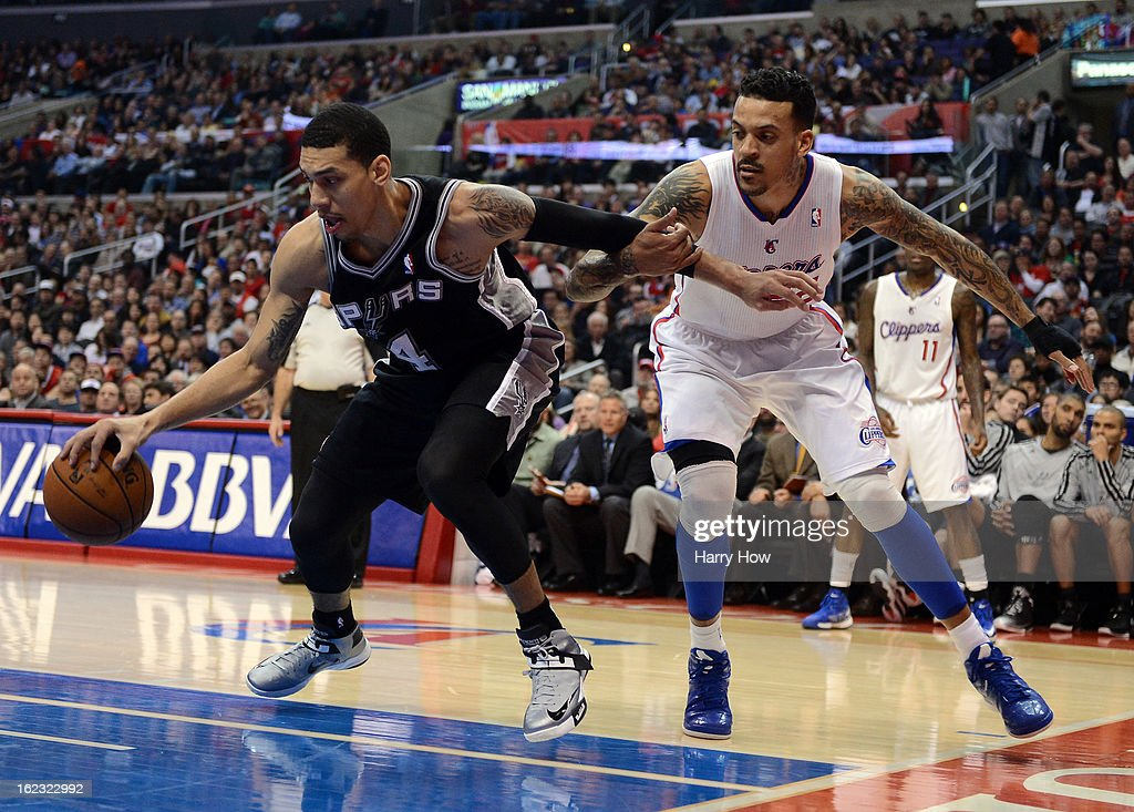 Danny Green #4 of the San Antonio Spurs controls a rebound away from Matt Barnes #22 of the Los Angeles Clippers at Staples Center on February 21, 2013 in Los Angeles, California.