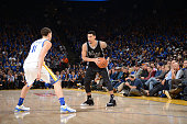Danny Green of the San Antonio Spurs dribbles against Klay Thompson of the Golden State Warriors on January 25 2016 at Oracle Arena in Oakland...