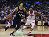 Danny Green of the San Antonio Spurs dribbles past Kyle Lowry of the Toronto Raptors during an NBA game at the Air Canada Centre on December 09 2015...