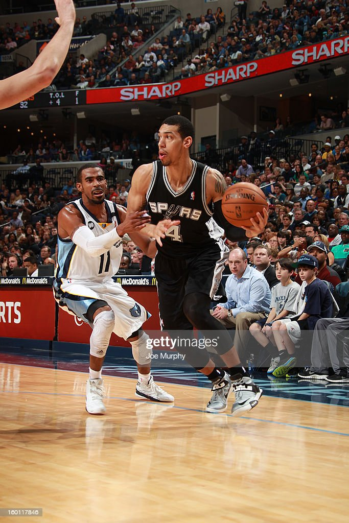 Danny Green #4 of the San Antonio Spurs drives against Mike Conley #11 of the Memphis Grizzlies on January 11, 2013 at FedExForum in Memphis, Tennessee.