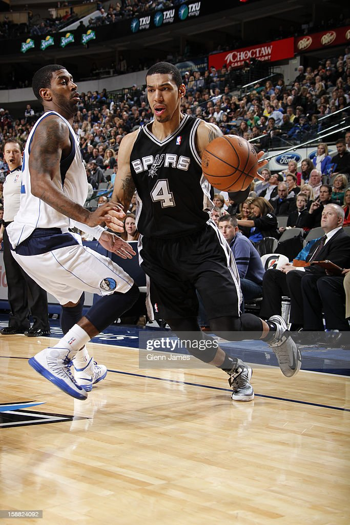 Danny Green #4 of the San Antonio Spurs drives against O.J. Mayo #32 of the Dallas Mavericks on December 30, 2012 at the American Airlines Center in Dallas, Texas.