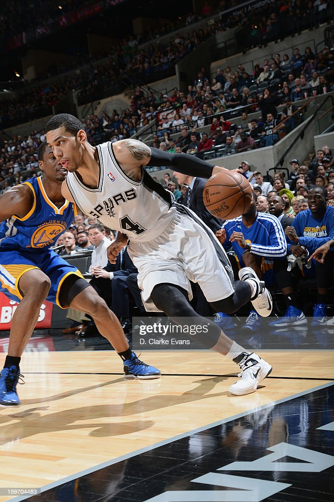 Danny Green #4 of the San Antonio Spurs drives baseline to score in a game against the Golden State Warriors on January 18, 2013 at the AT&T Center in San Antonio, Texas.