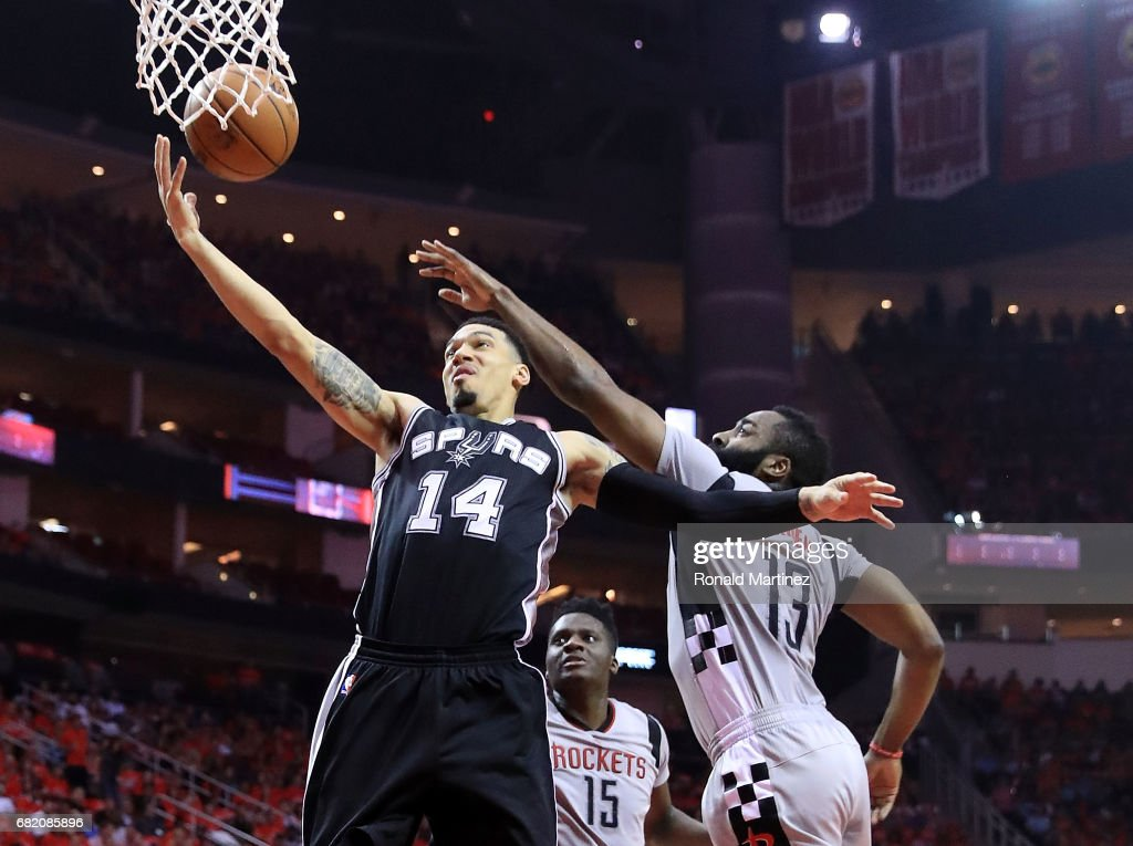 Danny Green #14 of the San Antonio Spurs drives between James Harden #13 and Clint Capela #15 of the Houston Rockets during Game Six of the NBA Western Conference Semi-Finals at Toyota Center on May 11, 2017 in Houston, Texas.