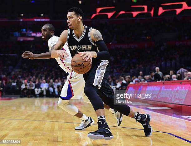 Danny Green of the San Antonio Spurs drives on Luc Mbah a Moute of the LA Clippers during a 106101 loss to the LA Clippers at Staples Center on...