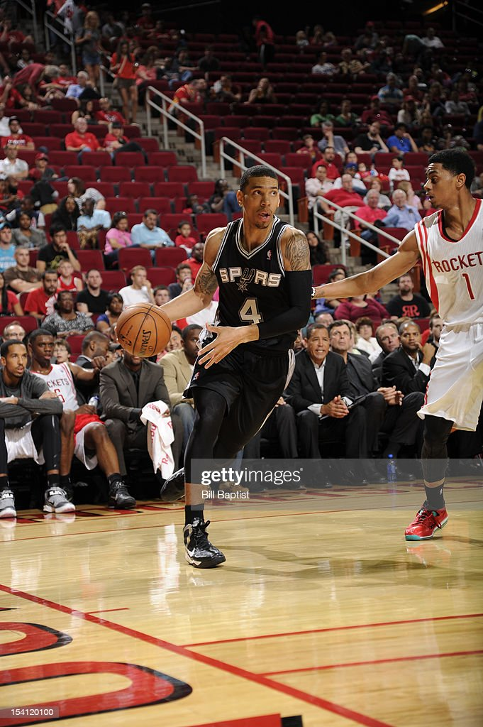 Danny Green #4 of the San Antonio Spurs drives the ball against <a gi-track='captionPersonalityLinkClicked' href=/galleries/search?phrase=Jeremy+Lamb&family=editorial&specificpeople=7407506 ng-click='$event.stopPropagation()'>Jeremy Lamb</a> #1 of the Houston Rockets during a pre-season game on October 14, 2012 at the Toyota Center in Houston, Texas.