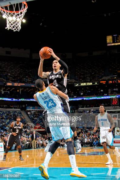 Danny Green of the San Antonio Spurs drives to the basket against Anthony Davis of the New Orleans Hornets on January 7 2013 at the New Orleans Arena...