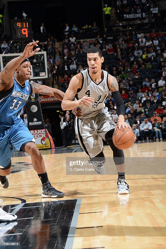 Danny Green #4 of the San Antonio Spurs drives to the basket against <a gi-track='captionPersonalityLinkClicked' href=/galleries/search?phrase=Dante+Cunningham&family=editorial&specificpeople=683729 ng-click='$event.stopPropagation()'>Dante Cunningham</a> #33 of the Minnesota Timberwolves on January 13, 2013 at the AT&T Center in San Antonio, Texas.