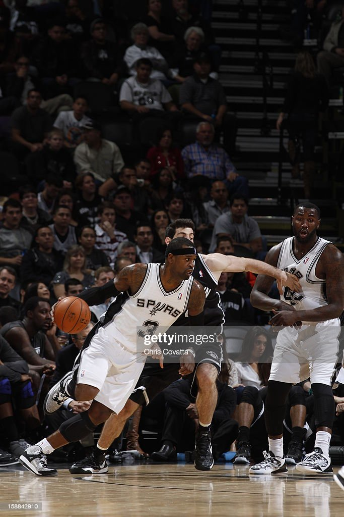 Danny Green #3 of the San Antonio Spurs drives to the basket against the Brooklyn Nets on December 31, 2012 at the AT&T Center in San Antonio, Texas.