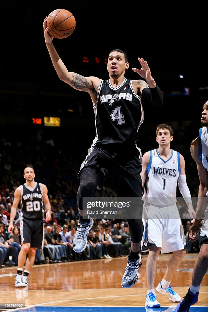 Danny Green #4 of the San Antonio Spurs drives to the basket against the Minnesota Timberwolves on March 12, 2013 at Target Center in Minneapolis, Minnesota.