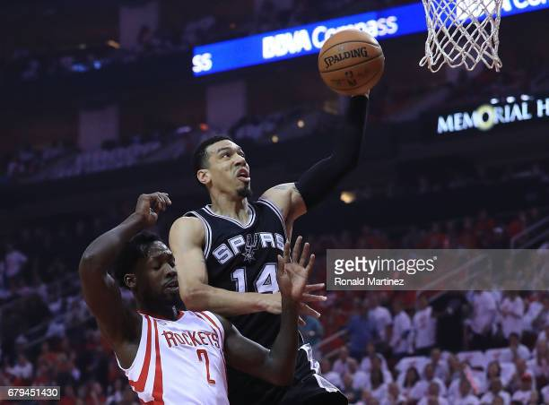 Danny Green of the San Antonio Spurs dunks against Patrick Beverley of the Houston Rockets during Game Three of the NBA Western Conference SemiFinals...