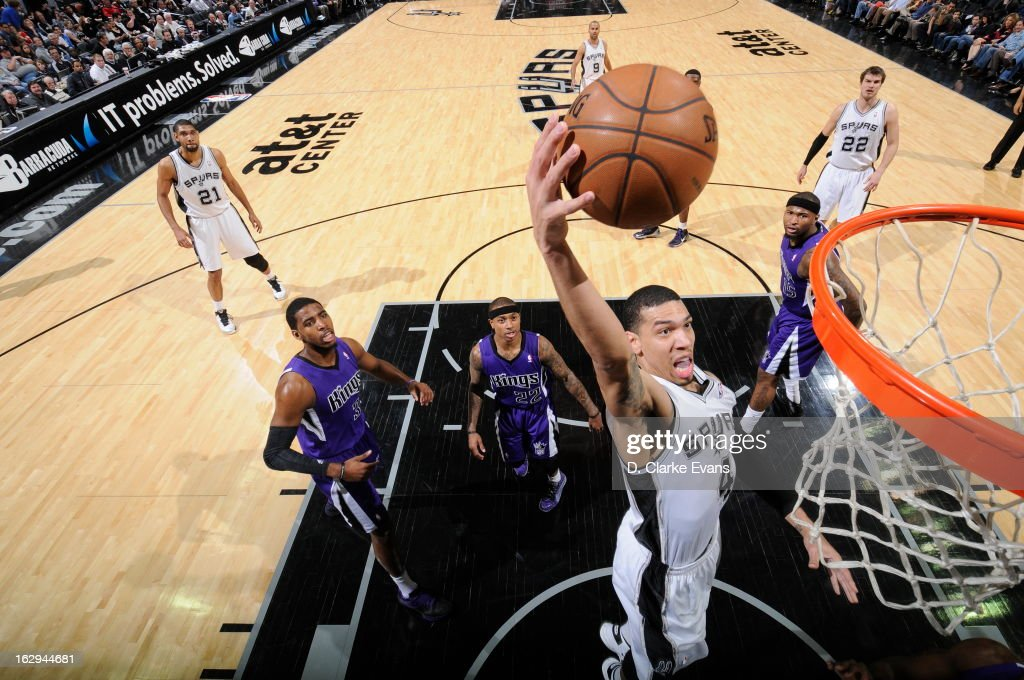 Danny Green #4 of the San Antonio Spurs dunks the ball against the Sacramento Kings on March 1, 2013 at the AT&T Center in San Antonio, Texas.