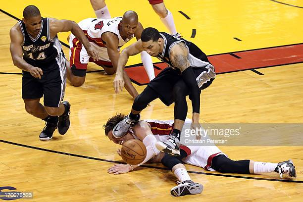 Danny Green of the San Antonio Spurs goes after a loose ball against Mike Miller of the Miami Heat during Game One of the 2013 NBA Finals at...