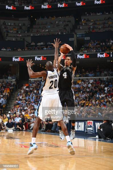 Danny Green of the San Antonio Spurs goes for a jump shot against Quincy Pondexter of the Memphis Grizzlies in Game Four of the Western Conference...