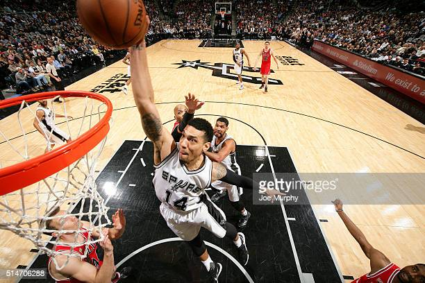 Danny Green of the San Antonio Spurs goes for the dunk during the game against the Chicago Bulls on March 10 2016 at the ATT Center in San Antonio...