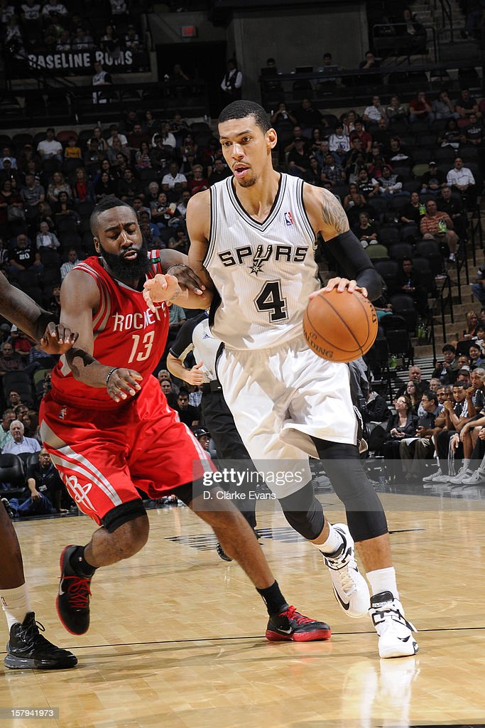 Danny Green #4 of the San Antonio Spurs handles the ball against James Harden #13 of the Houston Rockets on December 7, 2012 at the AT&T Center in San Antonio, Texas.