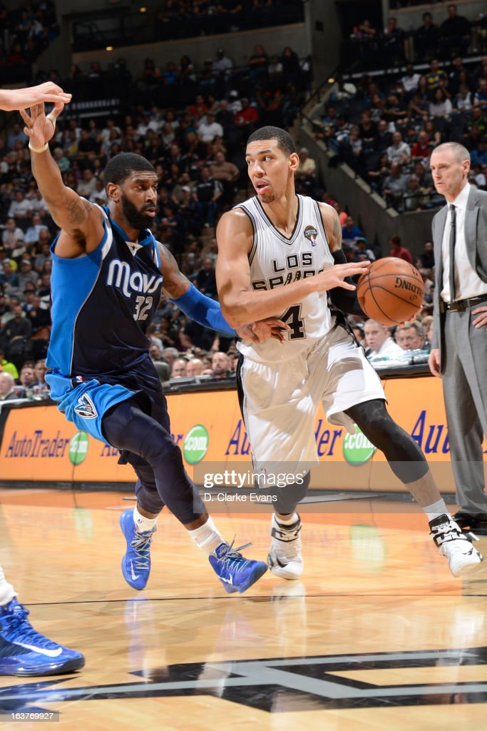 Danny Green #4 of the San Antonio Spurs handles the ball against O.J. Mayo #32 of the Dallas Mavericks on March 14, 2013 at the AT&T Center in San Antonio, Texas.