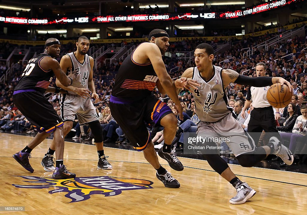 Danny Green #4 of the San Antonio Spurs handles the ball guarded by Jared Dudley #3 of the Phoenix Suns during the first half of the NBA game at US Airways Center on February 24, 2013 in Phoenix, Arizona.