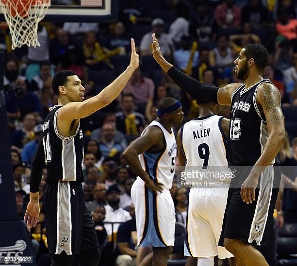 Danny Green of the San Antonio Spurs high fives teammate LaMarcus Aldridge during the second half of Game Four against the Memphis Grizzlies of the...