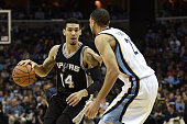 Danny Green of the San Antonio Spurs is defended by Tayshaun Prince of the Memphis Grizzlies during a game at the FedExForum on December 30 2014 in...