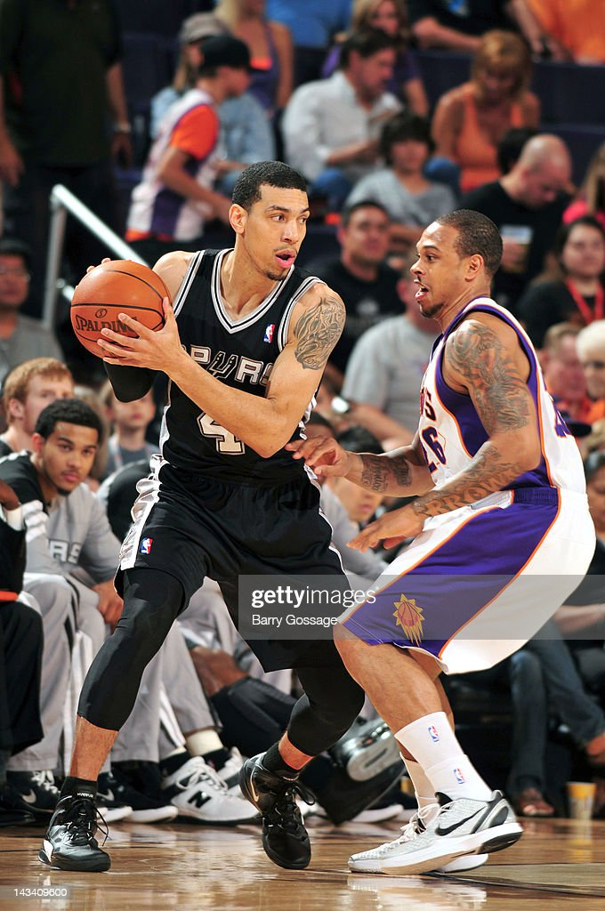 Danny Green #4 of the San Antonio Spurs is guarded by Shannon Brown #26 of the Phoenix Suns on April 25, 2012 at U.S. Airways Center in Phoenix, Arizona.