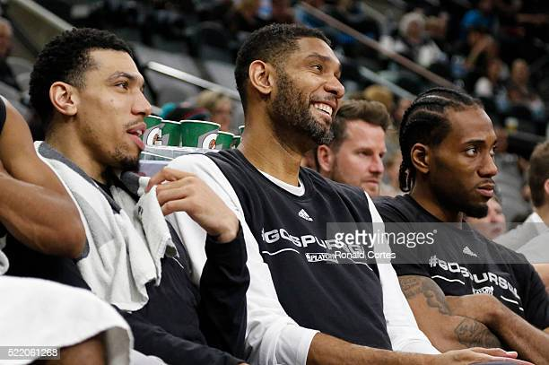 Danny Green of the San Antonio Spurs jokes with Tim Duncan during the fourth quarter of Game One of the Western Conference Quarterfinals against the...
