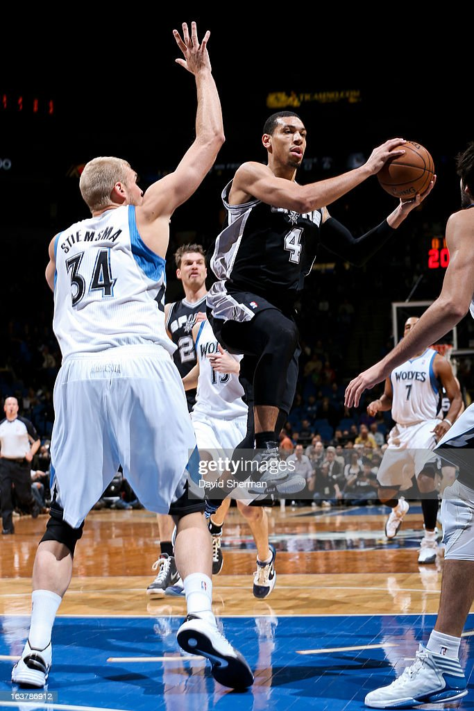 Danny Green #4 of the San Antonio Spurs looks to pass the ball in the lane against Greg Stiemsma #34 of the Minnesota Timberwolves on March 12, 2013 at Target Center in Minneapolis, Minnesota.