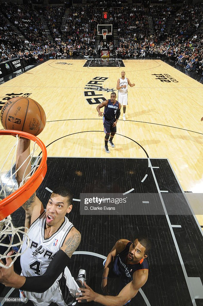 Danny Green #4 of the San Antonio Spurs puts the ball up against the Charlotte Bobcats on January 30, 2013 at the AT&T Center in San Antonio, Texas.