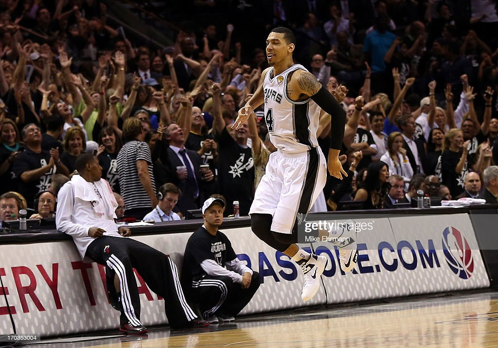 Danny Green #4 of the San Antonio Spurs reacts after making a three-pointer in the fourth quarter against the Miami Heat during Game Three of the 2013 NBA Finals at the AT&T Center on June 11, 2013 in San Antonio, Texas.