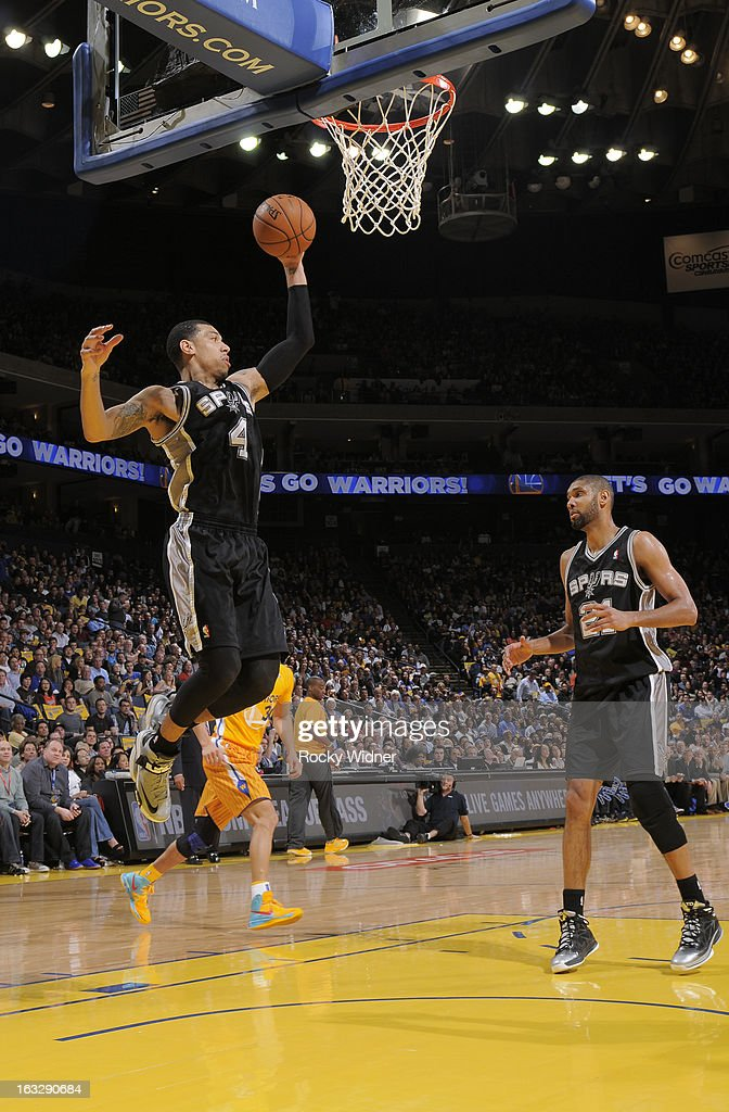 Danny Green #4 of the San Antonio Spurs rebounds against the Golden State Warriors on February 22, 2013 at Oracle Arena in Oakland, California.