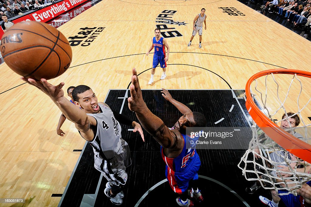 Danny Green #4 of the San Antonio Spurs shoots a layup against Jason Maxiell #54 of the Detroit Pistons on March 3, 2013 at the AT&T Center in San Antonio, Texas.