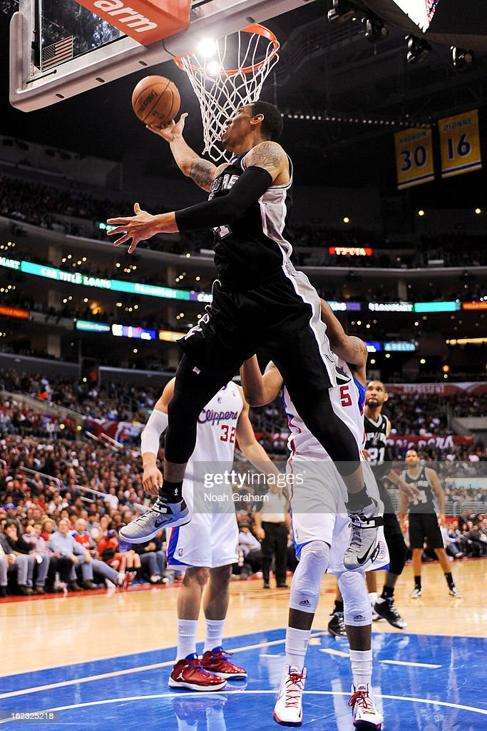 Danny Green #4 of the San Antonio Spurs shoots a reverse layup against the Los Angeles Clippers at Staples Center on February 21, 2013 in Los Angeles, California.