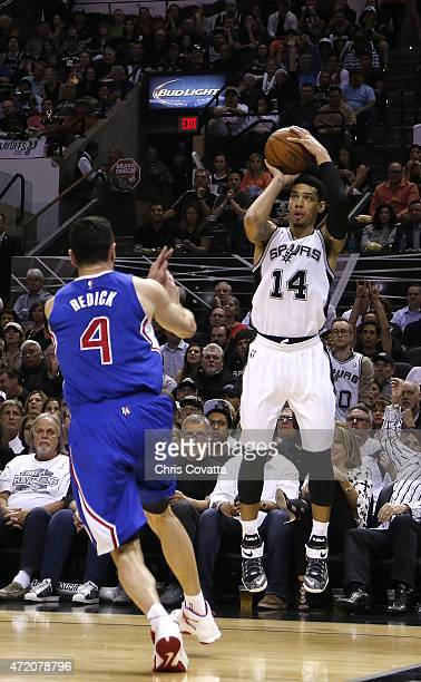 Danny Green of the San Antonio Spurs shoots a three point shot over JJ Redick of the Los Angeles Clippers during Game Six of the Western Conference...