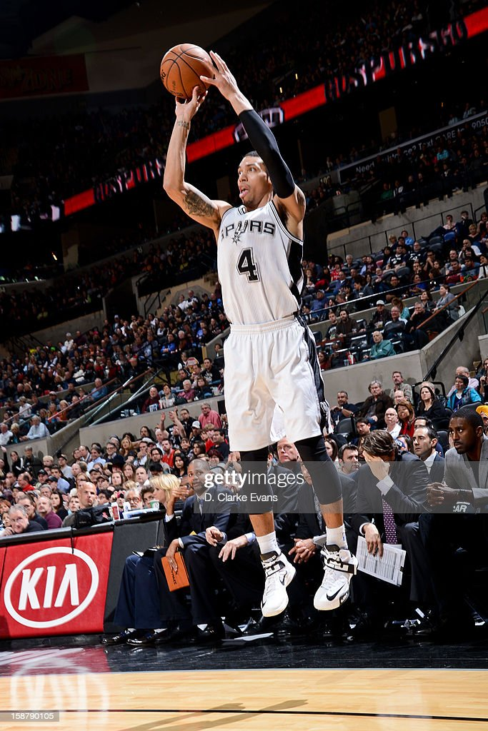 Danny Green #4 of the San Antonio Spurs shoots a three-pointer against the Houston Rockets on December 28, 2012 at the AT&T Center in San Antonio, Texas.