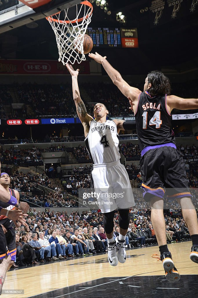 Danny Green #4 of the San Antonio Spurs shoots against Luis Scola #14 of the Phoenix Suns on February 27, 2013 at the AT&T Center in San Antonio, Texas.