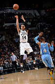 Danny Green of the San Antonio Spurs shoots against Randy Foye of the Denver Nuggets on April 3 2015 at the ATT Center in San Antonio Texas NOTE TO...