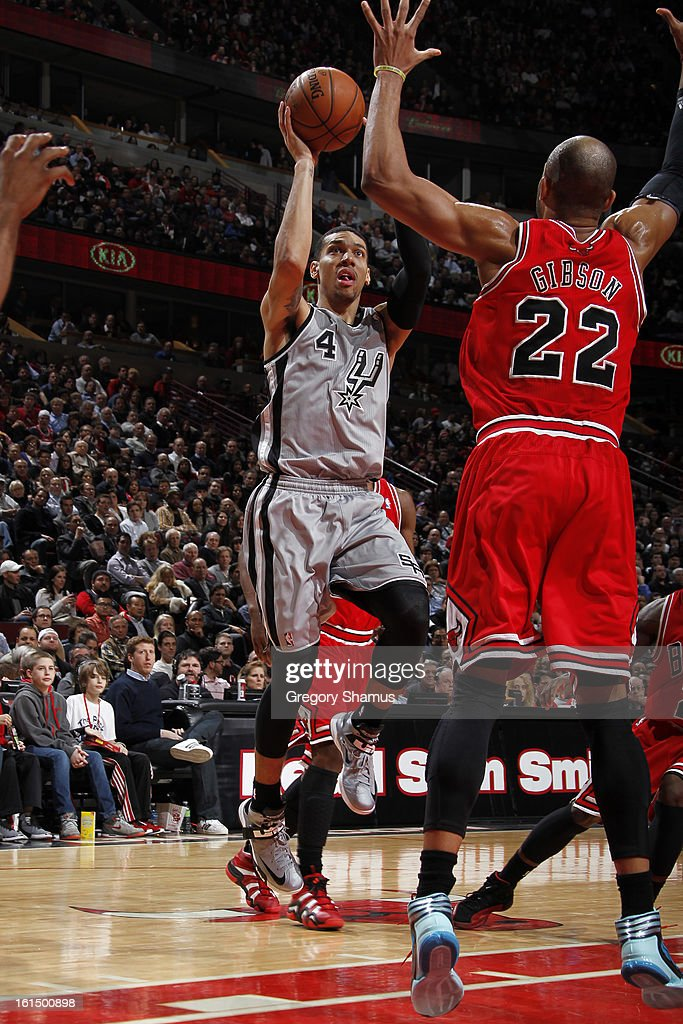 Danny Green #4 of the San Antonio Spurs shoots against Taj Gibson #22 of the Chicago Bulls on February 11, 2013 at the United Center in Chicago, Illinois.