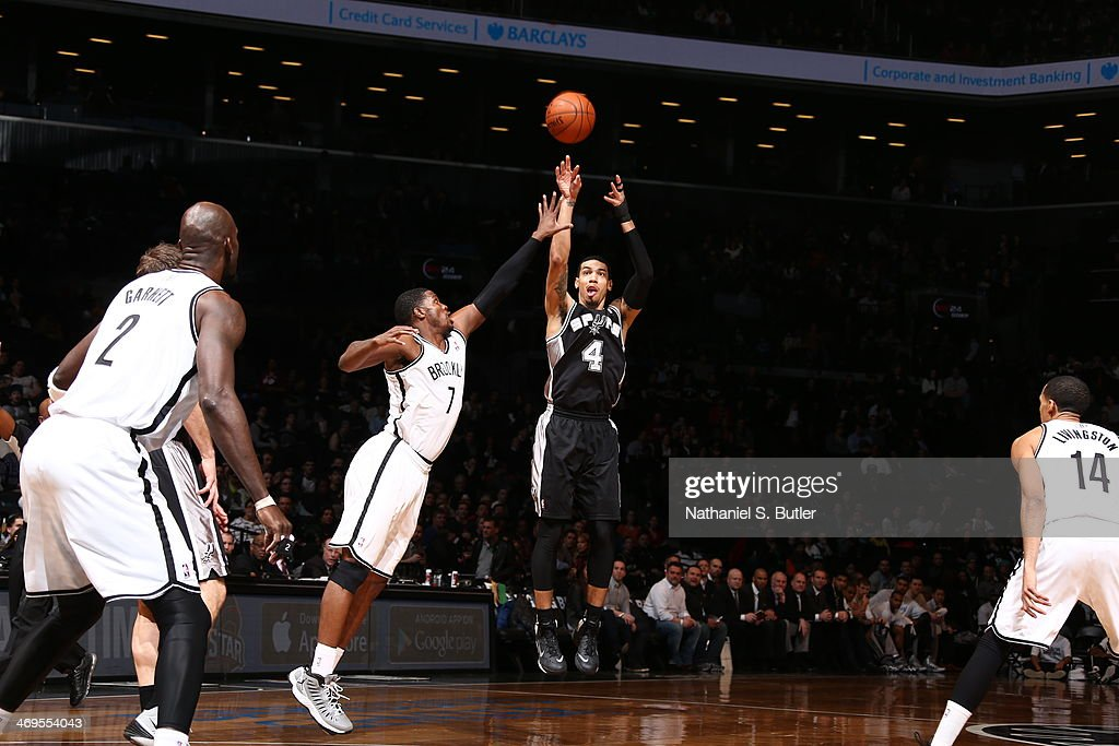 Danny Green #4 of the San Antonio Spurs shoots against the Brooklyn Nets at the Barclays Center on February 06, 2014 in the Brooklyn borough of New York City.