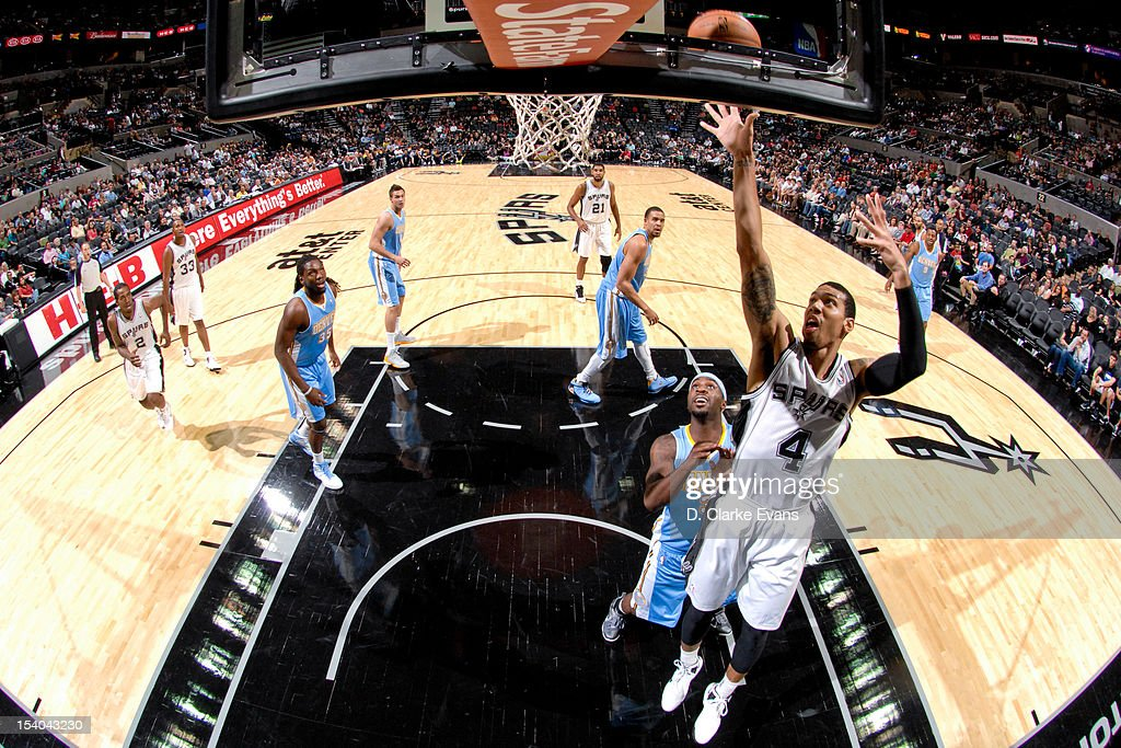 Danny Green #4 of the San Antonio Spurs shoots against <a gi-track='captionPersonalityLinkClicked' href=/galleries/search?phrase=Ty+Lawson&family=editorial&specificpeople=4024882 ng-click='$event.stopPropagation()'>Ty Lawson</a> #3 of the Denver Nuggets during a pre-season game on October 12, 2012 at the AT&T Center in San Antonio, Texas.