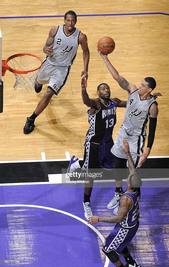 Danny Green #4 of the San Antonio Spurs shoots against Tyreke Evans #13 of the Sacramento Kings on February 19, 2013 at Sleep Train Arena in Sacramento, California.
